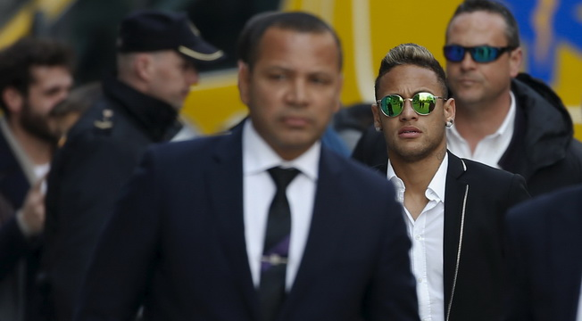 Barcelona's soccer player Neymar and his father arrive to testify at Spain's High Court in Madrid